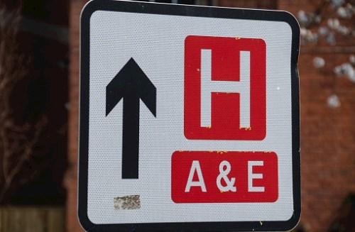 Roadsign pointing to hospital with Accident & Emergency department